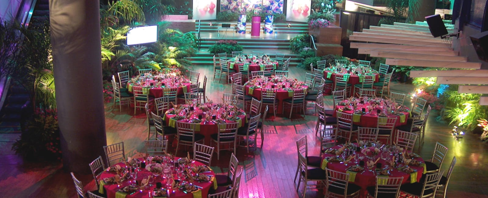 Tables are beautifully set for a corporate dinner and gala