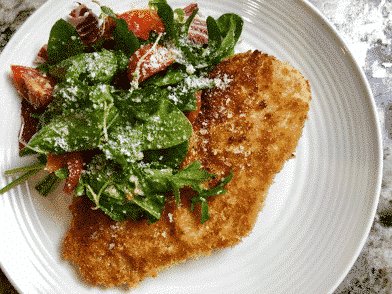 parmesan-chicken-paillard-salata-verde-arugula-end-of-season-toy-box-tomatoes-charred-lemon-beurre-blanc